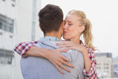 Woman kissing man cheek — Stock Photo