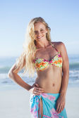 Blonde in bikini and sarong smiling — ストック写真