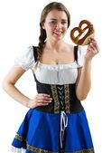 Pretty oktoberfest girl holding pretzel — Stock Photo