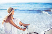 Blonde in on bike ride at beach — Stock Photo