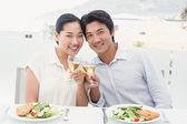 Asian couple having meal together — Stock Photo
