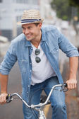 Hip man in denim on his bike — Stock Photo