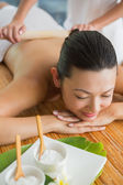 Brunette getting a bamboo massage — Stock Photo