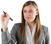 Businesswoman writing with pen — Stockfoto