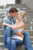 Couple sitting on steps showing affection — Foto de Stock