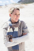 Blonde on the beach in woolen scarf — Stock Photo