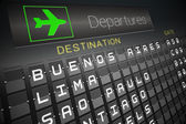 Black departures board for south america — Stock Photo