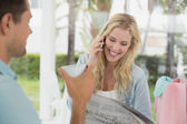 Blonde talking on phone while having coffee — Stock Photo