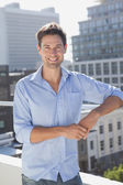 Handsome man  on his balcony — Stock Photo