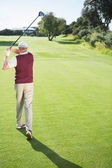 Golf player taking a shot — Stock Photo