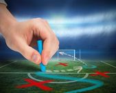 Hand drawing tactics on football pitch — Stock Photo