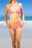 Fit woman in bikini on the beach — Stock Photo