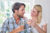 Couple enjoying white wine — Stock Photo