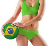 Girl holding brasil ball — Stockfoto