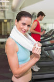 Brunette with towel over shoulders — Stock Photo