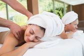 Friends getting massages together — Stock Photo