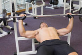 Bodybuilder lifting heavy barbell weight — Stock Photo