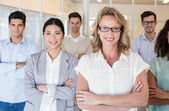 Business team smiling with arms crossed — Stock Photo