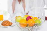 Fruit bowl on breakfast table — Stock Photo