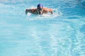 Schwimmer machen den Butterfly-Strich — Stockfoto