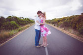 Couple standing on the road hugging — Stock Photo