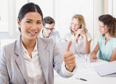 Businesswoman smiling during meeting — Stock Photo