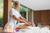 Brunette getting a shoulder massage — Stock Photo