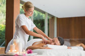 Brunette getting a shoulder massage — Zdjęcie stockowe