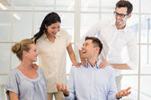 Business team congratulating colleague — Stock Photo