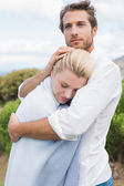 Protective man hugging his girlfriend — Stock Photo