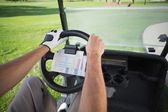Golfer driving his golf buggy forward — Stock Photo