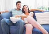 Couple watching tv on the couch — Stock Photo