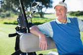 Golfer driving his golf buggy — Stock Photo