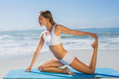 Blonde in seated yoga pose — ストック写真