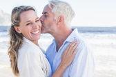 Man kissing his partner on the cheek — Stock Photo
