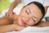 Brunette getting a back massage — Stock Photo