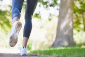Woman jogging on path in the park — Stock Photo