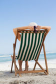 Woman sitting in deck chair — Stock Photo