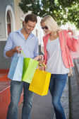 Happy couple on a shopping trip — Foto Stock