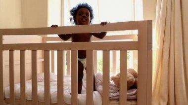 Cute baby girl in her crib — Vídeo de stock