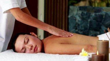 Peaceful brunette enjoying a massage — Stock Video