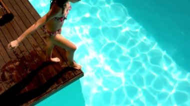 Brunette diving in the swimming pool — Stock Video