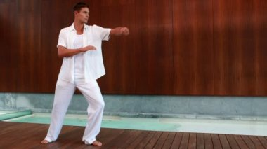 Calm man in white doing tai chi — Vidéo