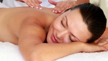 Beautiful brunette getting a massage — Stock Video