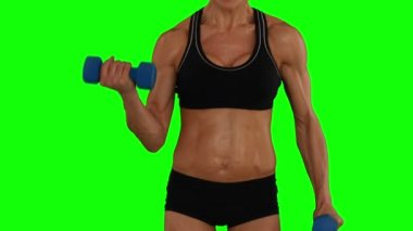 Super fit woman lifting dumbbells — Stok video