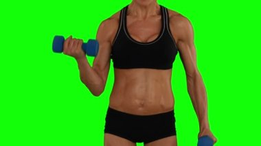 Super fit woman lifting dumbbells — Wideo stockowe