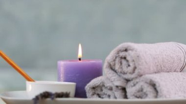 Beauty treatment in bowl presented on plate with candle at the spa — Stock Video