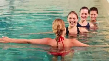 Fit women doing aqua aerobics in the pool — Vídeo Stock