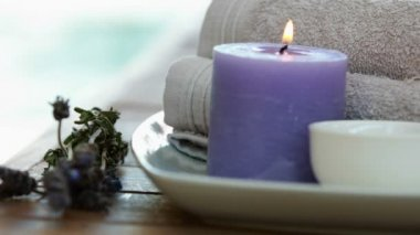 Beauty treatment in bowl presented on plate with dried lavender — 图库视频影像