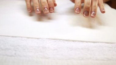 Hands showing fresh french manicure — Stockvideo